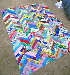 I want to make a t-shirt quilt that doesn't look like all the others, which are honestly pretty ugly, just a bunch of mismatched squares. Here's one that's a little different.