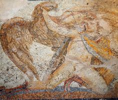 Archaeological Museum of Thessaloniki:          One of the two smaller panels framing a larger one with a dionysiac composition, from the main room of a wealthy residence. (200-250 A.D). It depicts Zeus snatching Ganymedes as an eagle.