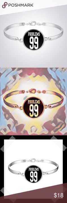 """""""99 Problems""""Cabochon Charm Bracelet in Silver Ton """"99 Problems""""Cabochon Charm Bracelet in Silver Tone . Material: Glass & Alloy Cabochon Glass Diameter: 25mm Length: 17cm . Please Note: Color may vary slightly due to the color calibration of each individual monitor. . 22DLN . Jewelry Bracelets"""