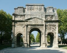 Wk 9 (limestone) Arch of Tiberius, Orange, France, c 25 CE -3 arcuaded bays -upper attic - battle w Gauls lower attic = bits that elide to naval battle -roman power on land and see as well as victory over gauls -short ends of arches - sea monsters -also depcitions of shields and swords on spandrels spandrel attic roundels - arch terminology