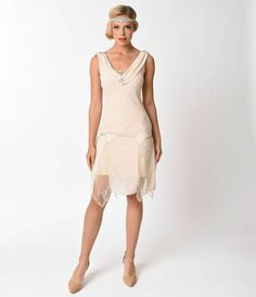 Love the look of flapper dresses but prefer something with a little less sparkle? Go for chic, sleek and sexy with this nude flapper dress from Unique Vintage. The simple, flattering silhouette is carefully embellishment with subtle accents of sequins and