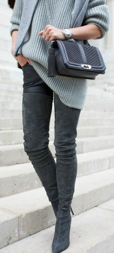 Thigh high boots are edgy and alternative; the perfect way to add flare to your every day look. This pair of suede style boots are worn with leather trousers and a simple knit sweater, a sophisticated and elegant look. Via Blair Eadie. Sweater/Leggings: Reed Krakoff, Boots: Tamara Mellon, Bag: NY Love.