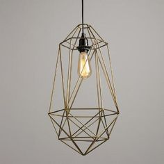 Crafted of iron wire with a sophisticated antique gold finish, our exclusive pendant boasts an intricate geometric design reminiscent of a birdcage. Enhance its rustic look with one of our vintage-style filament bulbs.