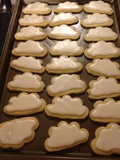 Cloud cookies / airplane birthday - use flower cutter, then cut cookies in half and top with white frosting.