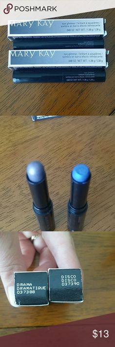 Two brand new Eye shadows Mary Kay These are both brand new! The blue one got stuck to the top of the lid, but both are new. Disco and Drama Mary Kay Makeup Eyeshadow