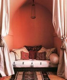 A cozy nook -- Here's another idea for a multi-purpose bedroom. Put the bed in a nook and cover with heavy curtains. Moroccan Design, Moroccan Decor, Moroccan Style, Cozy Nook, Cozy Corner, Bed Nook, Marrakesh, Riad Essaouira, Living Tv