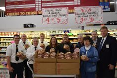 Fareway employees and representatives from Food At First and Bethesda food pantry pose with the 90 hams the store donated on Wednesday. The grocery store donated the hams with food company Hormel as part of a nationwide donation campaign. Photo by Dan Mika/Ames Tribune http://www.amestrib.com/news/20161221/local-fareway-donates-90-hams-to-food-pantries