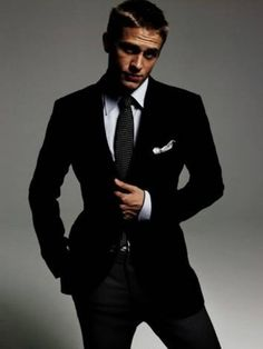 A cleancut Charlie Hunnam (Sons of Anarchy) in a suit. @Janessa Kenney  LOVEE!