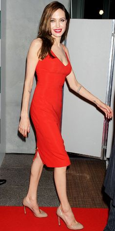 Angelina Jolie turned up the heat at the Tokyo Moneyball premiere in a red Atelier Versace slip dress and nude pumps.