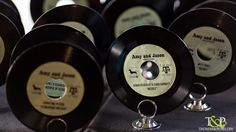 Wedding Detail - Table Markers Made From Old 45 Records With Guests' Names and Album Titles to Designate Table Assignments!