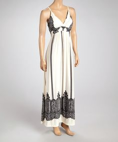 Let others envy the breezy style of this free-spirited maxi. A surplice silhouette flatters the figure, while versatility prevails with a look that easily styles as a beachy cover-up too! So pretty!!