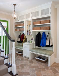 Organized Mudroom | Organize and Inspire------Fabulous and I love the green door to top it off.