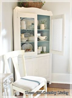 Town and Country Living - chicken wire replaces glass on cabinet doors