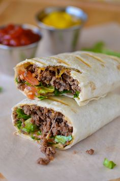Bacon Cheeseburger Wraps _ are nothing short of total ease & deliciousness. All the components of a bacon cheeseburger wrapped up in a flour tortilla. Ground beef, cheddar cheese, & of course bacon. I love me some bacon. :) Especially, in these wraps! You can add in any traditional cheeseburger toppings you like. Shredded lettuce, sliced tomato, & ketchup & mustard. Mmmm!