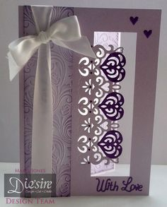 Marie Jones - Die'sire Edge'ables Rococo - Centura Pearl Lavender - Embossalicous Vintage Floral Rose Swirl folder - Distress ink Dusty Concord - Collall All Purpose glue - Purple card - Ribbon & gems -#crafterscompanion