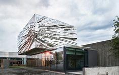 snøhetta cantilevers metallic steel extension in norwegian art museum