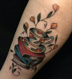 Tattoo of books and teacup Dustin Richards at sugarfoot