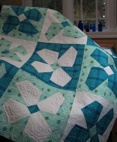 This is a lovely only 3 fabrics used quilt