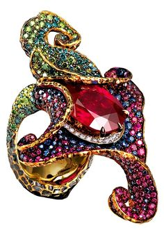 """Amaryllis"" ring with a rare ""pigeon's blood"" Burmese ruby and all colored diamonds and sapphires, fixed next to the central stone, A one of a kind Flowers collection from the Jewellery Theatre, Bond street in London."