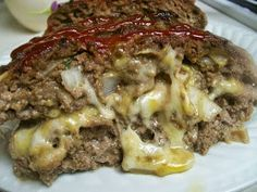 Cheese-Stuffed Meatloaf Recipe - Looks good.and Dangerous ~Cheese-Stuffed Meatloaf~ ½ lb mozzarella cheese, shredded; Meatloaf Recipe With Cheese, Cheese Stuffed Meatloaf, Stuffed Meatloaf Recipes, I Love Food, Good Food, Yummy Food, Cheesy Meatloaf, Cheeseburger Meatloaf, Meatloaf Muffins