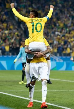 #TOPSHOT Luan of Brazil celebrates his goal with teammate Neymar scored against Colombia during their Rio 2016 Olympic Games men's football...