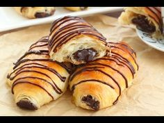 Layer upon layer of light, buttery flaky pastry filled with rich chocolate and drizzled with more chocolate, these chocolate croissants are mind-blowing!