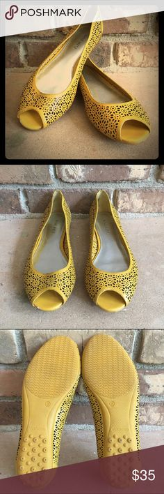 Mustard Yellow Nine West Laser Cut Peep Toe Flats Mustard yellow Peep Toe Flats, all over Laser Cut Floral design.  Leather.  Excellent condition.  There is a small knick on the front of the right shoe ( see photo #4) and the inside of the shoe (the silver part) has obvious signs of wear.  Cute for spring and the warmer Fall months! Nine West Shoes Flats & Loafers