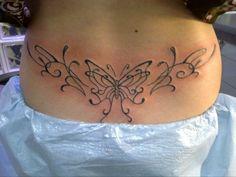 tattoo tatouage bas dos papillon arabesque
