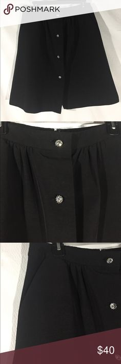 """Talbots Black Skirt Excellent condition. Black with beautiful glass buttons. Buttons in front are decorative except for top button. Back zipper with hook and eye closure. Fully lined. Side pockets. Size 6. 71% cotton, 29% rayon. Waist about 30"""", hips about 42"""", about 21.5"""" long. Not from a smoke free house. M64 Talbots Skirts"""