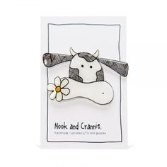 The sweetest of creatures, Cute Cow loves nothing more than a hot cuppa and good dunking biscuit. She has a talent for growing beautiful garden plants, her favourite being the English daisy. This quirky brooch is handmade from shrink plastic, printed with my own design. Hand cut and baked, it's then coated with resin for …