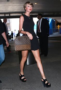 Pin style: Taylor showed off her famous legs in the simple but eye-catching number...