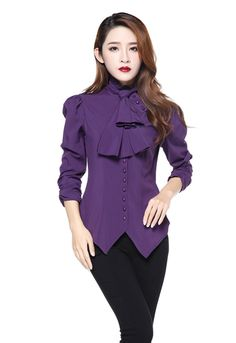 Beautiful Gothic Victorian style blouse is made from purple polyester and spandex mix and has a removable self tie at the neck. There are purple buttons down the centre front and puff shoulders with r