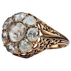Antique Georgian Rose Cut Diamond Cluster Ring c1820. An elaborate openwork 18K gold ring, circa 1820, is set with eight antique rose cut diamonds.