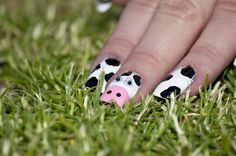 Big toe as a cow and all the little toes will be spots.. lol love the googly eyes...not sure those would stay on very long though. :)