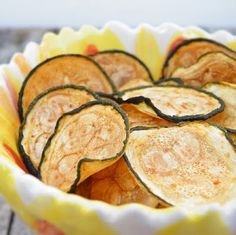 They taste good.  Baked Zucchini Chips      1 zucchini   canola cooking spray  seasoned salt, or other seasoning(s) of your choice    Preheat oven to 225 degrees Fahrenheit.  Line a baking sheet with parchment paper or nonstick foil, and spray with canola oil.  Set aside.    Slice zucchini into thin medallions, about the thickness of a quarter.  (You can either use