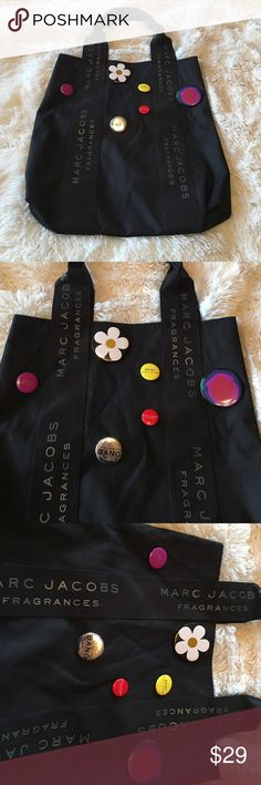 "Marc Jacobs Huge Bag...✔️...With Marc Jacobs Pins Marc Jacobs Huge Black and Silver Bag with Marc Jacobs pins...Measurements are 16"" wide x 18"" long...it has 6 pins on it...Purple one says Lola Marc Jacob, Silver one says Marc Jacobs Bang, Yellow one says Daisy Marc Jacobs, Red one says Marc Jacob Fragrances, the other two are as pictured....the drop is 20""...Nice Nice Bag ✔️ Marc Jacobs Bags Cosmetic Bags & Cases"