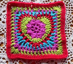 I Heart this Granny Square.  The link on the picture has a chart/symbol pattern that is easy to follow.  For written instructions in English, see here:  http://www.ravelry.com/patterns/library/grandmas-heart-square