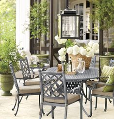A classic dining set turns this patio into the perfect sunny spot for enjoying a meal, a cup of coffee or a chat with a friend {Ballard Designs}