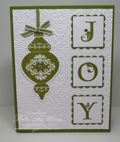 handmade Christmas card ... column of three inchies spell JOY ... die cut ornament ... embossing folder texture on main paenl ... two color card in white and olive ... Stampin' Up!