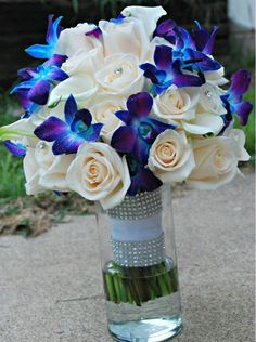 Bayley: <span>Ivory roses and blue stem-dyed dendrobium orchids</span>