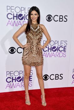 Actress Victoria Justice shined on the People's Choice Awards red carpet in an embellished high-neck minidress.