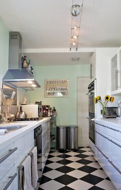 Elongated Patterns: Choose geometric and striped walls and floors that draw the eye lengthwise or vertically and make the room appear longer or taller than it actually is. E.g. lay the checked tile diagonally, instead of square.