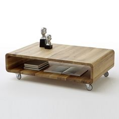 Witham Coffee Table Rectangular In Knotty Oak With Rollers makes a remarkable addition in your living room Finish: Knotty Oak Features: