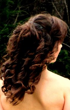 Curled, then pinned as an updo with clips.