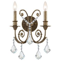 Add a sophisticated accent to your home décor with this indoor bronze wall sconce, featuring a bronze-finished fixture that sets the stage for an array of hand-polished crystal drop-down shades. This elegant sconce would look great in an entrance hall.