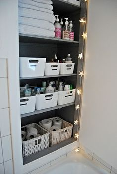 bathroom organization - for the downstairs bathroom  -  like the basket idea to keep things together