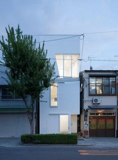 Designed by Kenji Ido of Ido Architectural Studio for a family of four in Osaka, Japan, this home makes use of the narrow lot by maximizing space with an open floorplan.