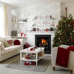 Christmas Living Room.  Love the merry Christmas prints above the fireplace.