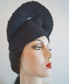 RESERVED - ON LAYAWAY - DO NOT PURCHASE Vintage Lilly Dache draped turban hat, c. 1940s, from the milliners East 56th Street, New York shop. The hat has a dramatic Old Hollywood Glam style for which the designer was recognized for. This hat looks like elaborately draped turban from the front while the back resembles a cloche style (my opinion only - check the photos for yourself to see this work of millinery art). Label: Lilly Dache (Paris New York), 78 East 56th St. Lilly Dache was…