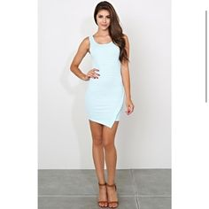 NEW. Sleeveless light blue dress NEW. Sleeveless knit dress featuring a scooped neckline with double stitching. Striped throughout. Envelope hemline with double stitching Dresses Mini